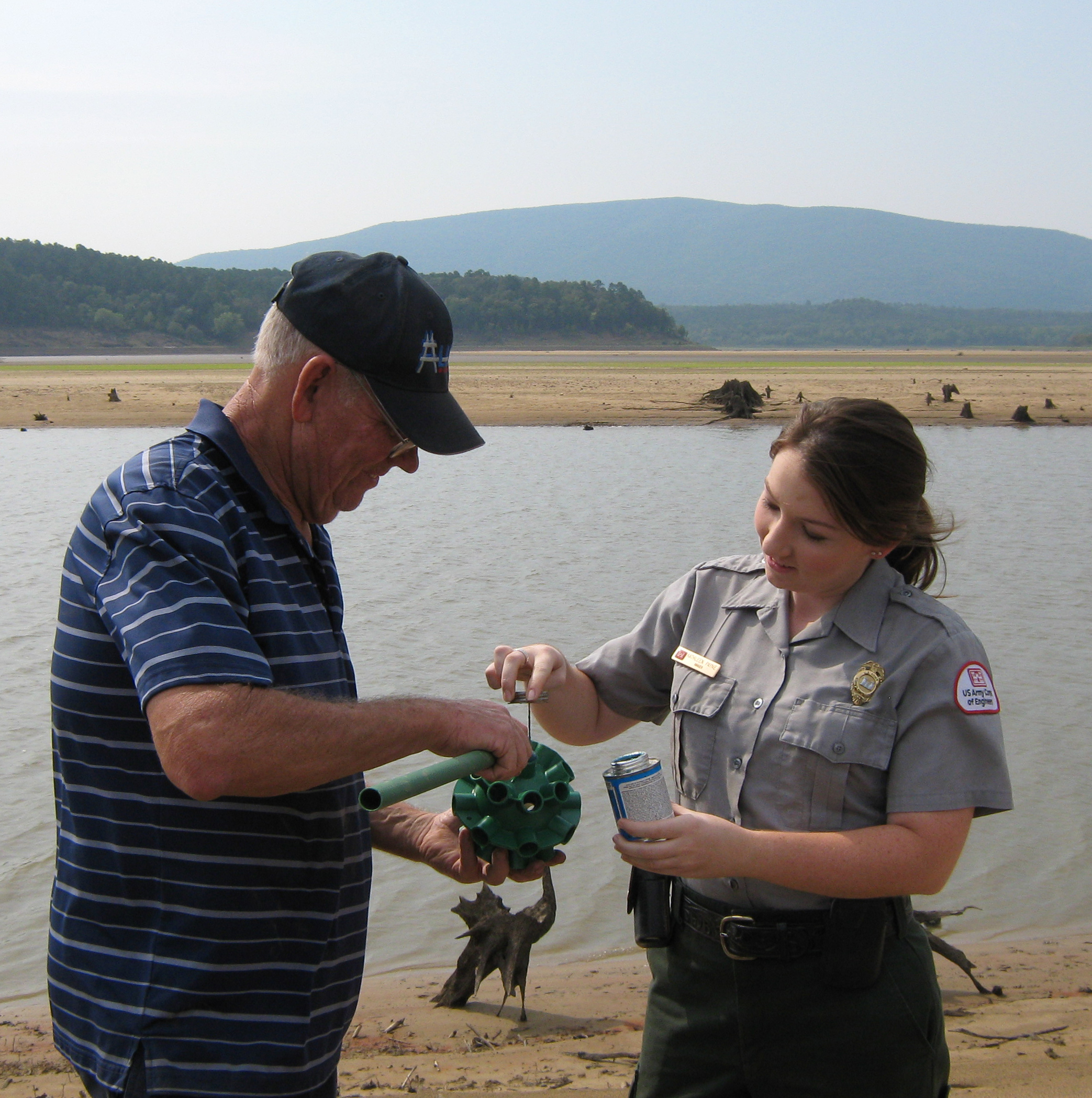 Volunteer and Park Ranger putting together a fish shelter
